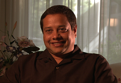 anil_henry_interview_still_03_250w.png